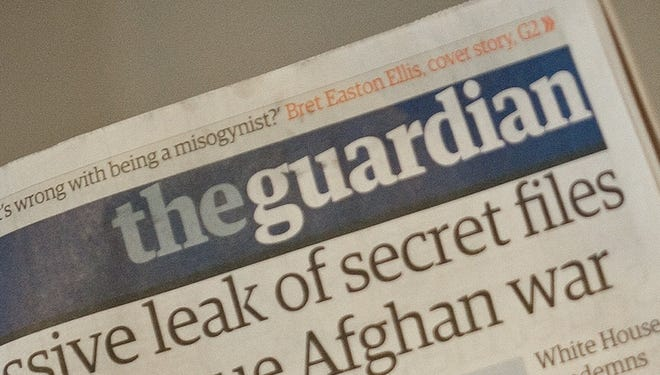 A copy of the Guardian newspaper during a press conference in London on July 26, 2010.