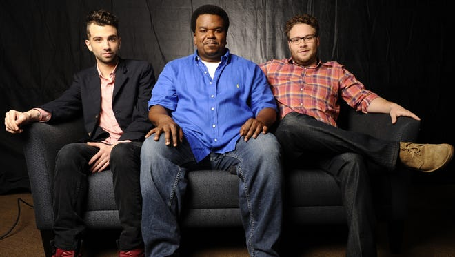 Famous friends Jay Baruchel, left, Craig Robinson and Seth Rogen face the apocalypse together in the new comedy 'This Is the End.'