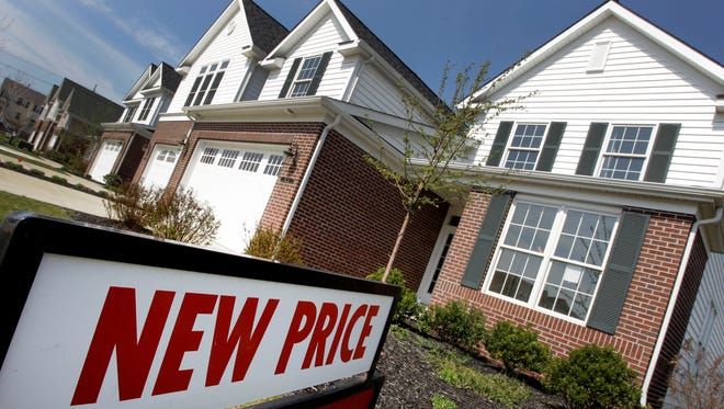 Newly-constructed homes are seen for sale with a new price in Pepper Pike, Ohio.