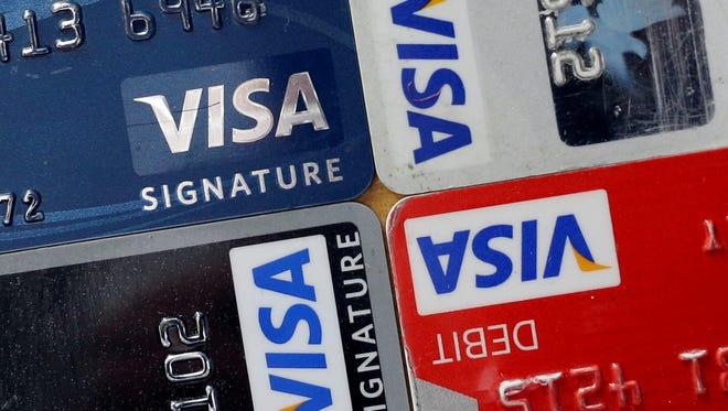 Visa credit and debit cards are displayed April 25, 2013,  in Baltimore.