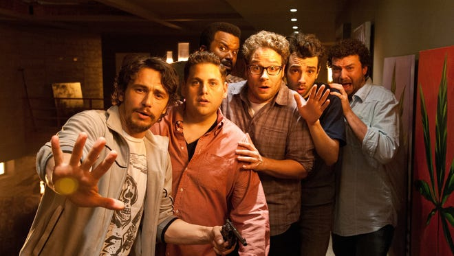James Franco, left, Jonah Hill, Craig Robinson, Seth Rogen, Jay Baruchel and Danny McBride face the apocalypse in the uneven but entertaining 'This Is the End.'