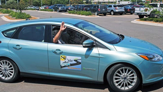Among the first buyers of the Ford Focus electric, Ty Newell of Urbana, Ill., gets a ride at the Michigan Assembly Plant in Wayne where his car was built.
