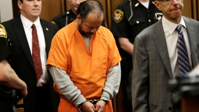 Ariel Castro, center, enters the courtroom for his June 12 arraignment in Cleveland.