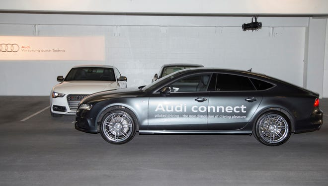 """An Audi """"Piloted Driving"""" car that can find a space in a garage and park itself was shown this year at the Consumer Electronics Show."""