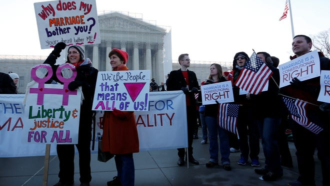 Supporters of same-sex marriage rally in front of the Supreme Court in Washington on March 26, the first day of two court cases that are before the court this week relating to gay marriage.