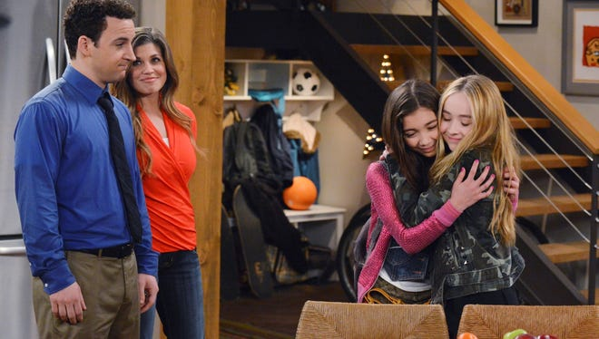 The 'Girl Meets World' cast features Ben Savage, left, and Danielle Fishel. They are joined by Rowan Blanchard and Sabrina Carpenter as their daughter and her best friend.