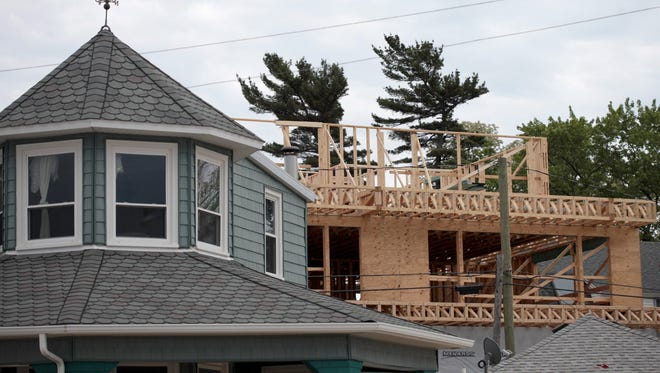 Construction crews build a new home in Laketown Township, Mich. on June 5, 2013.
