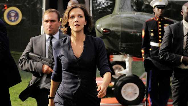 Maggie Gyllenhaal's no damsel in distress in 'White House Down.' Her Secret Service agent character takes command of the response after the White House is attacked.