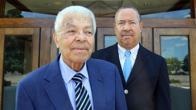 Father and son, Nick Hood II, left, and Nick Hood III, current pastor of Plymouth United Church of God in Christ, were both at the King march in Detroit 50 years ago.