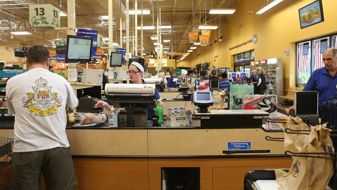 Cashier Kelsey Bird checks out a customer at the Kroger store in Symmes Township, Ohio on June 13. Kroger has boosted check-out time at its stores with Que Vision - techonology that counts individual store traffic and determines wait times.