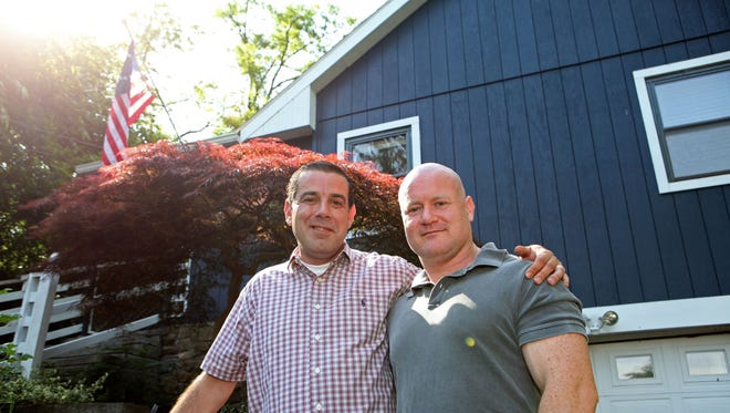 Gary Wanderlingh and his husband Sam Conlon are photographed June 18 at their home in New Fairfield, Conn.