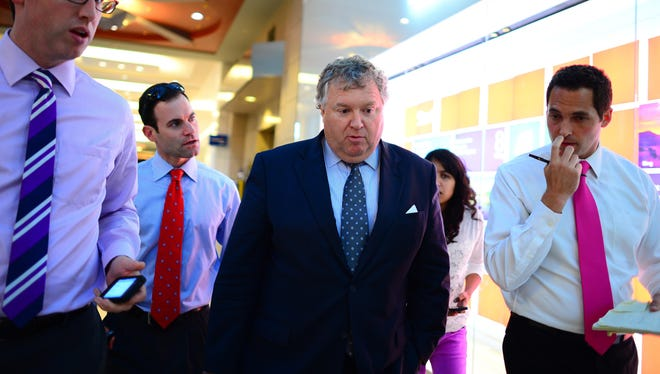 Michael Fee (center) is the attorney for New England Patriots tight end Aaron Hernandez.
