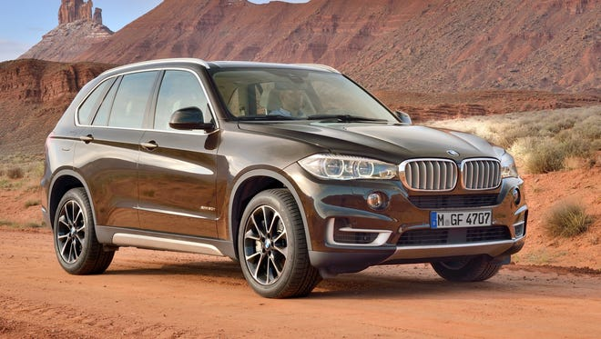 The redesigned third-genertaion 2014 BMW X5 -- show here is the xDrive 50i model with design package -- goes on sale in November with a starting price up about  11% and all-wheel drive no longer standard.