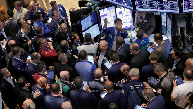 Traders gather on the floor of the New York Stock Exchange on June 21, 2013.