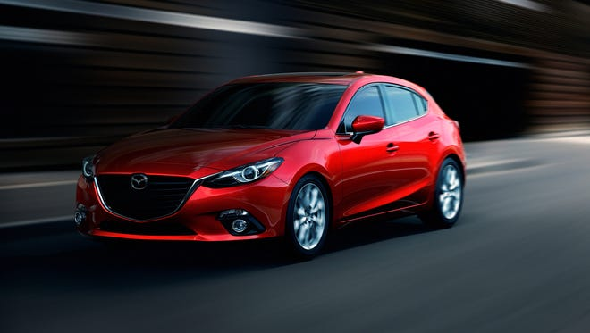 Mazda showed off its 2014 Mazd3 compact hatchback in New York City. It features a different look, more technology and goes on sale in the fall.
