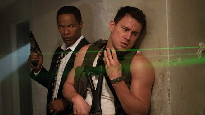 Channing Tatum, right, stars as a veteran and Capitol Hill police officer who must protect the president (Jamie Foxx) after a terrorist attack on the White House.