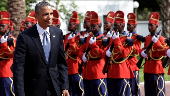 President Obama is welcomed by a Senegalese honor guard as he arrives at the presidential palace in Dakar, Senegal, on June 27.