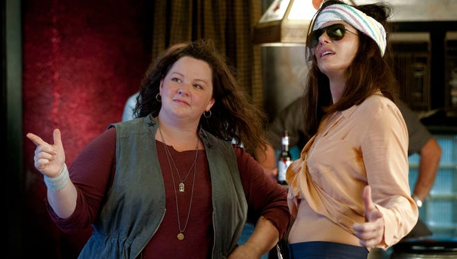 Melissa McCarthy and Sandra Bullock star as a pair of mismatched law enforcement officers in 'The Heat.'