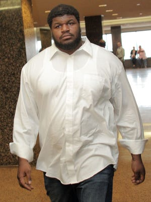 Dallas Cowboys' Josh Brent leaves court in Dallas after a hearing to determine if he violated the terms of his bail.