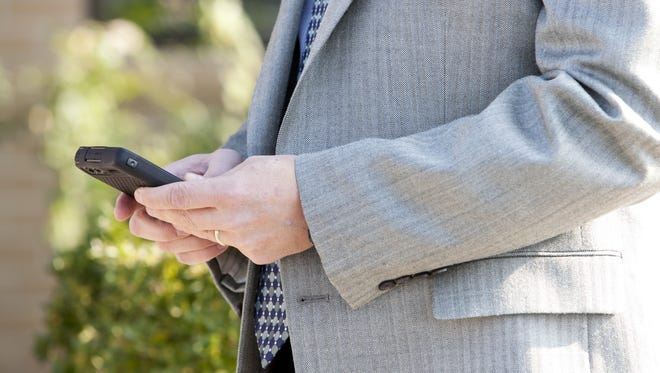 Dowling Aaron attorney Greg Miskulin of Fresno, CA uses his personal mobile device.