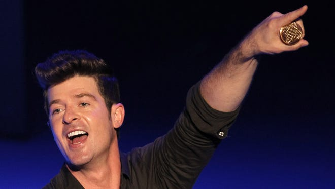 Robin Thicke, whose song 'Blurred Lines' is still gaining even more momentum, performs at L.A.'s Orpheum Theatre in September 2012.