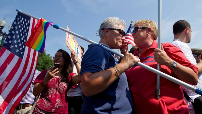 Partners Deb Gardiner, 55,  left, and Michele Horrigan, 51, of Gaithersburg, Md., react after the Supreme Court declared DOMA unconstitutional.