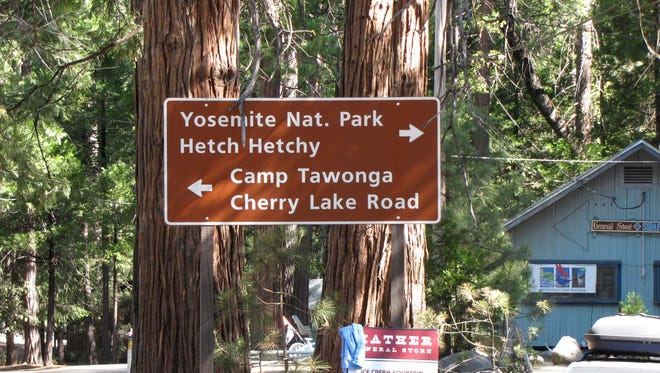 A road sign showing the way to Camp Tawonga, a children's camp near Yosemite National Park.
