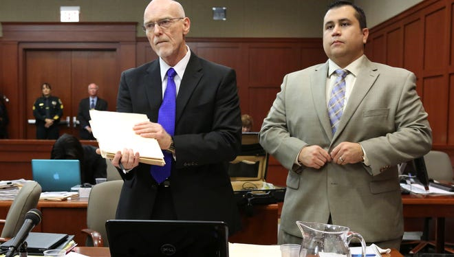 George Zimmerman, right, stands next to one of his defense attorneys, Don West, during his trial in Seminole circuit court Friday in Sanford, Fla.