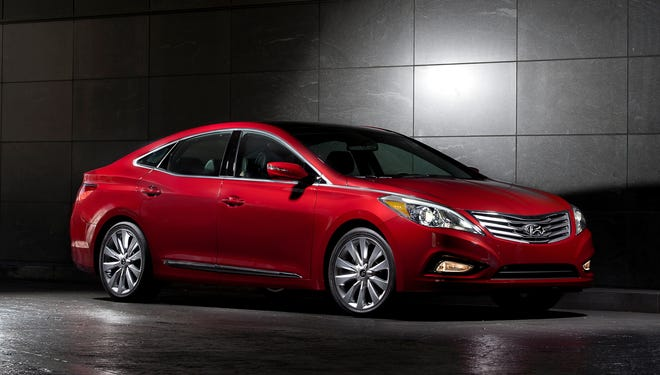 Hyundai is recalling some 2012 and 2013 Azera sedans because the front passenger's air bag could inflate when it shouldn't.