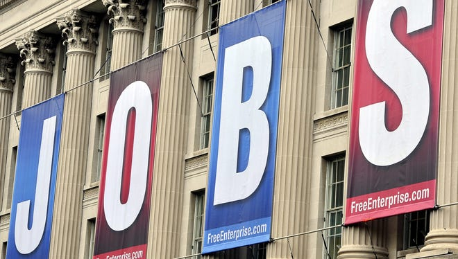 """A giant sign reading """"jobs"""" hangs outside the U.S. Chamber of Commerce building in Washington in 2011."""