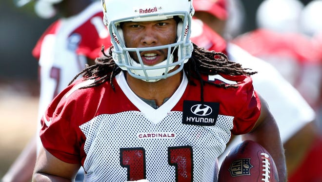 Arizona Cardinals wide receiver Larry Fitzgerald goes through drills during OTAs on May 14, 2013 in  Tempe, Ariz.