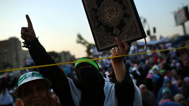 Women participate in a demonstration in Cairo on July 10, 2013, in support of deposed Egyptian President Mohammed Morsi on the first day of Ramadan, the sacred holy month for Muslims where many will fast from sun-up to sun-down.