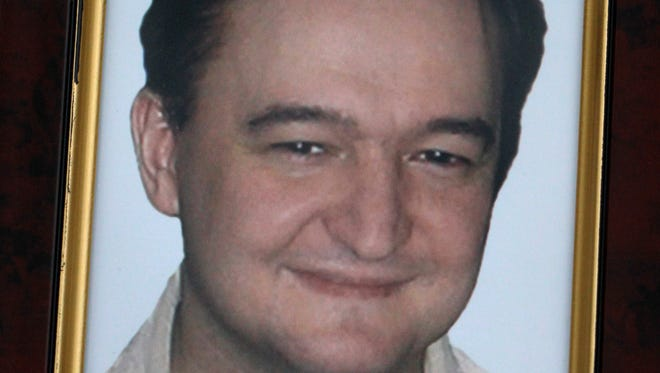 This Nov. 30, 2009, file photo shows a portrait of lawyer Sergei Magnitsky.
