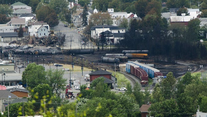 Scorched oil tankers remain on July 10, 2013, at the train derailment site in Lac-Megantic, Quebec.