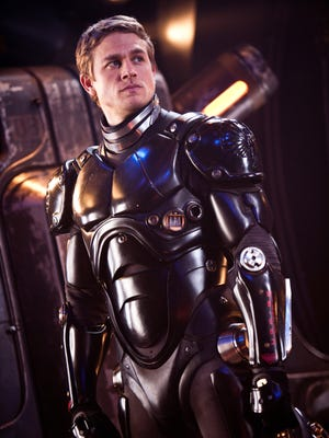 Charlie Hunnam pilots a giant robot in defense of humanity against massive monsters in 'Pacific Rim.'