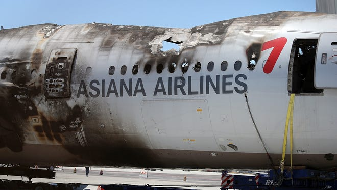The wrecked fuselage of Asiana Airlines flight 214 sits in a storage area at San Francisco International Airport on July 12, 2013.