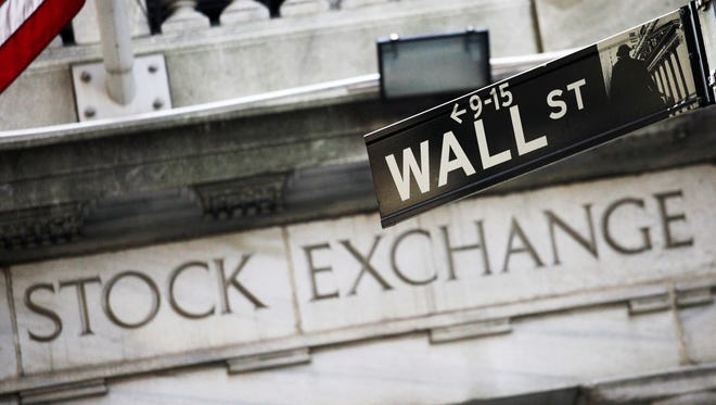 The sign for Wall St. is shown outside the New York Stock Exchange on July 15, 2013.