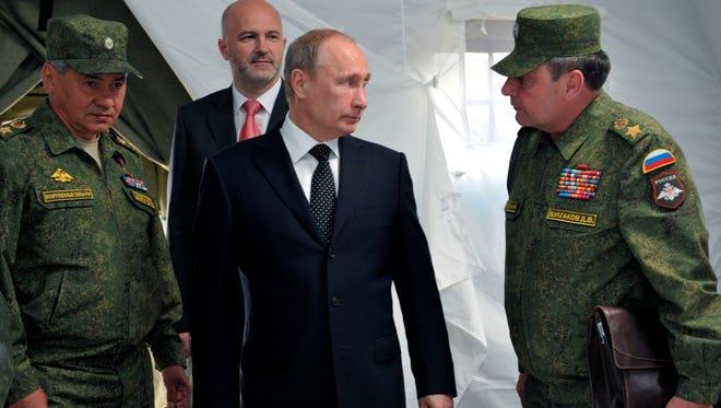 Russian President Vladimir Putin, center, near Baikal Lake, Russia, on July 17, 2013.