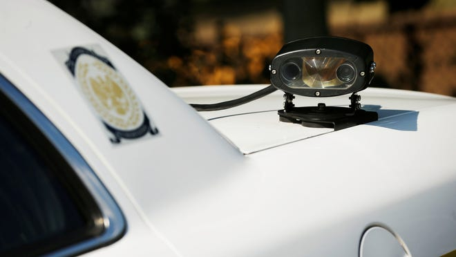 An Alexandria, Va., police car has a license plate scanner mounted on the trunk. Police across the USA have used the devices to amass  hundreds of millions of  digital records on the location  of every car and truck they pass, the ACLU says.
