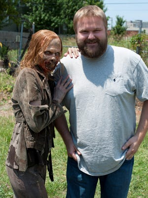 'Walking Dead' creator Robert Kirkman poses with one of his undead TV creations.