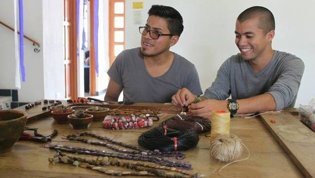 Javier Villatoro, of Antigua, Guatemala, left,  is learning how to build a business making jewelry with help from American missionaries who teach business skills to budding entrepreneurs. At right is Noe Rivera.