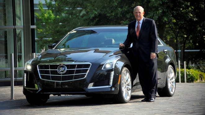 GM CEO Dan Akerson shows off the 2014 Cadillac CTS midsize sedan at USA TODAY in McLean, Va. He said an extra-large car, bigger than the Cadillac XTS, is coming in two years.