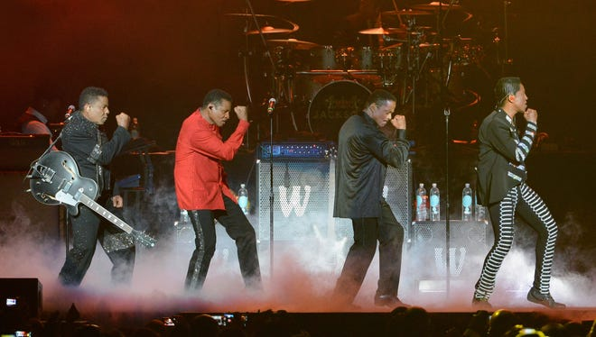From left, Tito Jackson, Jackie Jackson, Marlon Jackson and Jermaine Jackson perform onstage at the 2013 BET Experience at Staples Center on June 30, 2013 in Los Angeles, Calif.