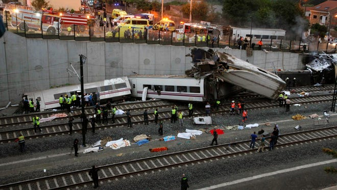 Emergency personnel respond to the scene of a train derailment in Santiago de Compostela, Spain, on July 24. A train derailed in northwestern Spain on Wednesday night, killing dozens.