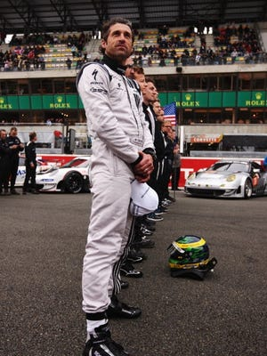 Patrick Dempsey stands for the French national anthem before the running of June's 24 Hours of LeMans endurance race.