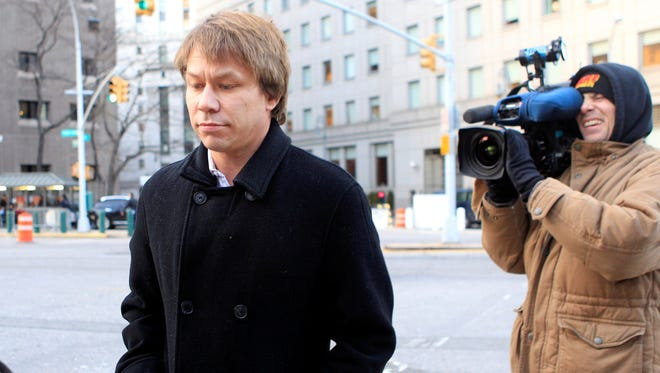 Jon Horvath, left, a former analyst at Sigma Capital Management, an affiliate of SAC Capital Advisors, has pleaded guilty to conspiracy and securities fraud for insider trading committed while at Sigma Capital. On July 25, federal prosecutors announced an indictment of SAC and Sigma Capital related to its insider trading investigation. Horvath is shown leaving Manhattan Federal court in New York on Jan. 18, 2012.