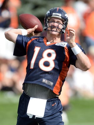Denver Broncos quarterback Peyton Manning (18) prepares to pass during training camp at the Broncos training facility in Englewood, Colo. on July 25, 2013.
