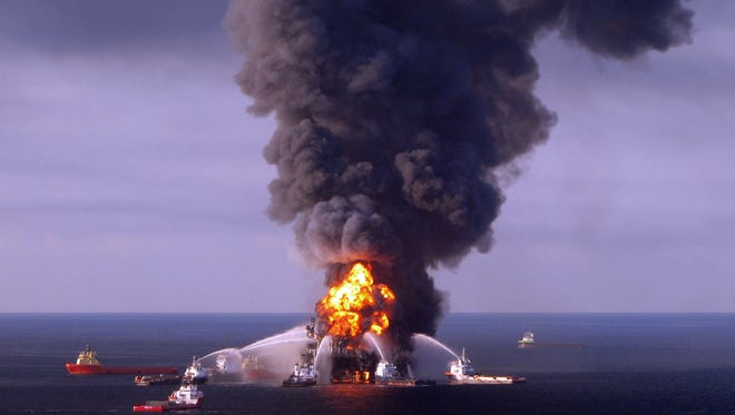 Fire boat response crews battle the blazing remnants of the off-shore oil rig Deepwater Horizon in the Gulf of Mexico on April 21, 2010.