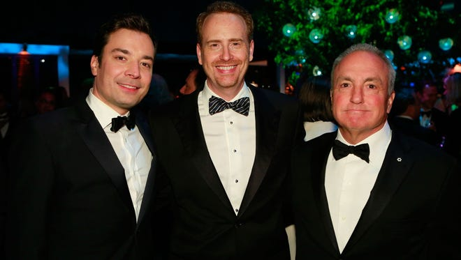 NBC Entertainment chief Robert Greenbatt is flanked by future 'Tonight' host Jimmy Fallon, left, and producer Lorne Michaels.