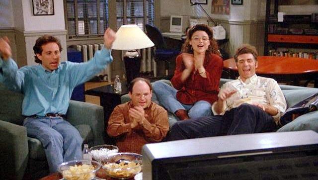 "Jerry Seinfeld, Jason Alexander, Julia Louis-Dreyfus and Michael Richards in a scene from ""Seinfeld."""